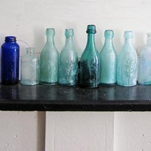 The mantle. An array of bottles and inks.